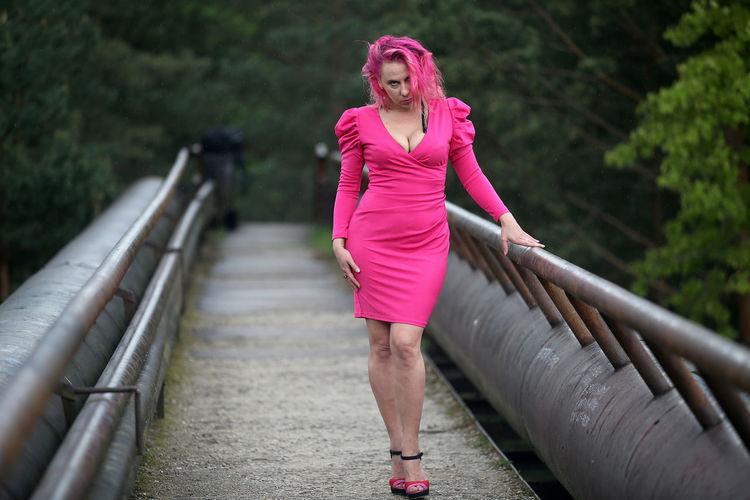 Full length of woman on footbridge