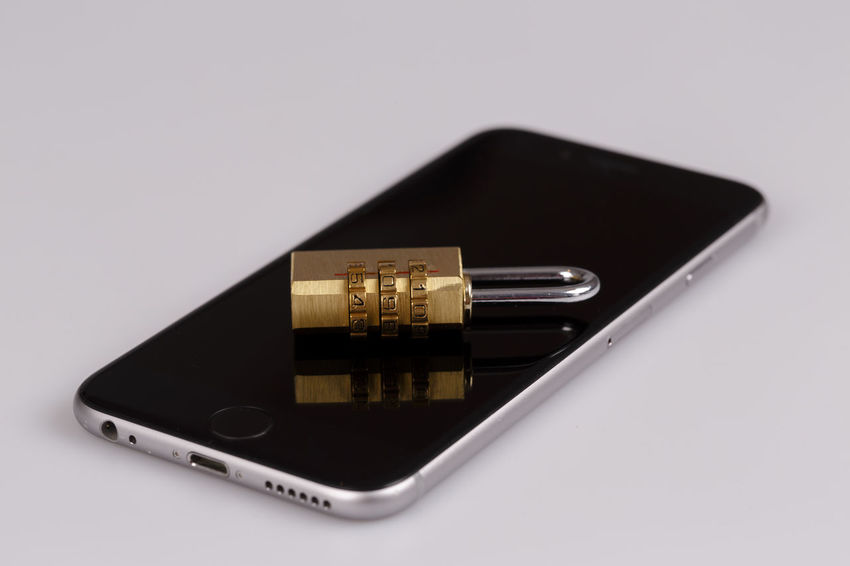 lock on cell phone - information security concept Lost Security Data Hacker IPhone Infosec Lock Password