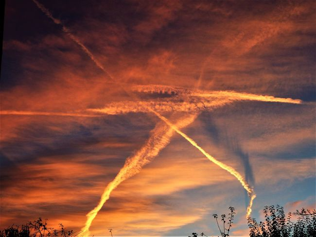 A Brief Look to The Sky Cloudscape Sign Colored Sky Contrail In The Sky Outdoors Scenics Sky Vapor Trail