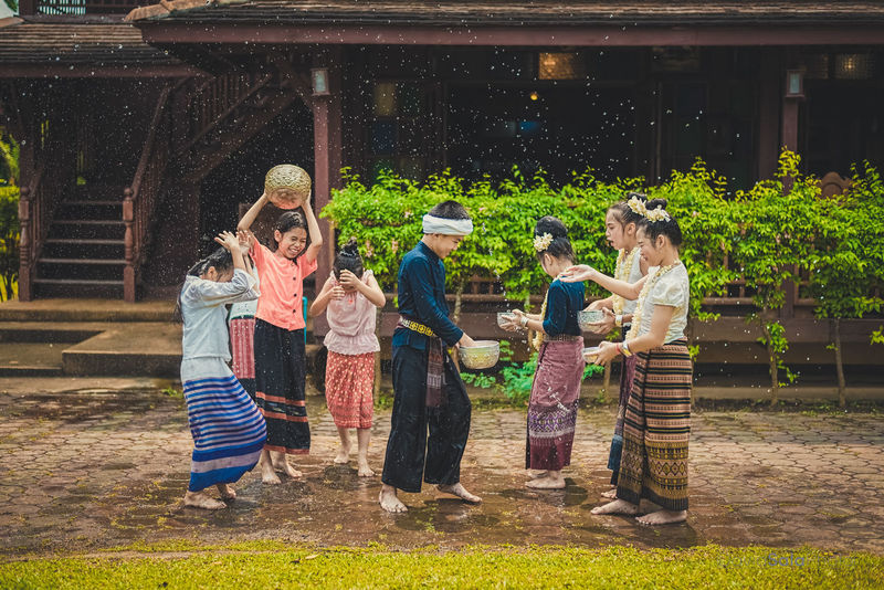 Traditional Song Kran Water Festival in Lanna Style Photo by: David Sala www.davidsalaphoto.com #lifephotography #photographer #chiangmai #thailand #beauty #peace #dreamer #streetphotography #portraitphotography #life #experiences #thepresetfactory #handsome #colors #green #strong #power #dark #waterfestival #children Chiang Mai | Thailand Children Dance Day Festival Friendship Fun Land Of Smiles Lanna Love Outdoors People Real People Skirts Smiles Splashing Togetherness Traditional Traditional Clothing Traditional Culture Water Young Adult Young Women