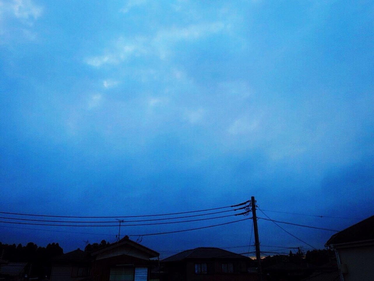 cable, cloud - sky, sky, connection, power line, no people, electricity, low angle view, power supply, silhouette, built structure, outdoors, blue, electricity pylon, building exterior, architecture, nature, telephone line, day