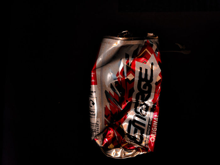 Black Background Box - Container Celebration Close-up Communication Copy Space Energydrink Holiday Illuminated Indoors  No People Red Still Life Studio Shot Surprise Text Western Script Wrapped