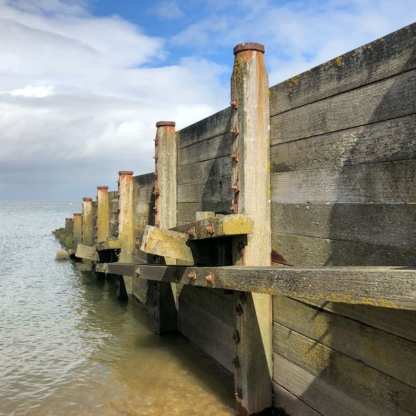 Barrier EyeEm Best Shots Whitstable Kent Coastline England Divide Wood Wooden Water Beach Photography Beach Seaside_collection Seaside Groyne Sky Water Architecture Built Structure Cloud - Sky Nature Sea Weathered Waterfront Wall