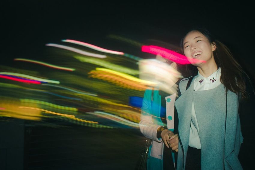 Streetphotography Shanghai China One Person Blurred Motion Night Smiling Motion Women Leisure Activity