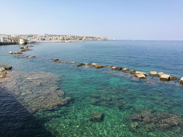 Sea Beach Water Horizon Over Water Sky Clear Sky Blue Day Beauty In Nature Travel Destinations Tranquility Beautiful Colors Summer Views Italy🇮🇹 Point Of View Tourism No People NoFilterNoEdition No Filter, No Edit, Just Photography Beautiful View Sicily Siracusa Sicily Colors Summer Color Beautiful