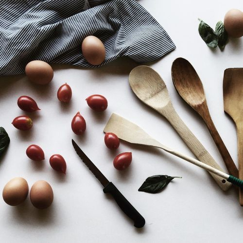 High angle view of egg and spoons on table