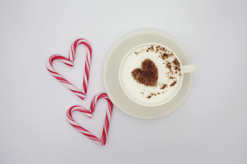 Cappuccino for special one Arrangement Backgrounds Beverage Candy Coffee Cup Creativity Cup Directly Above Drink Food And Drink Freshness Heart High Angle View Hot Drink Milk Non-alcoholic Beverage Ocassion Overhead View Red Refreshment Still Life Studio Shot White Background
