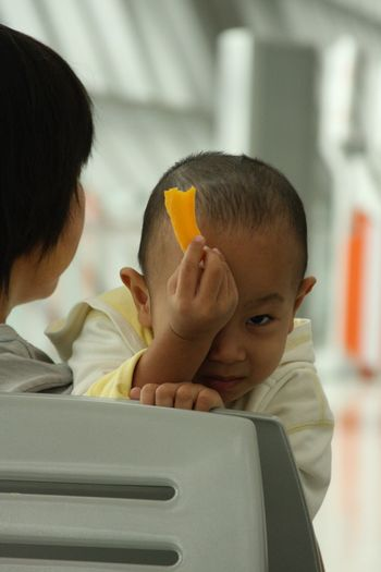 Capture The Moment Hideandseek Behind Mango at Bangkok Thailand Airport