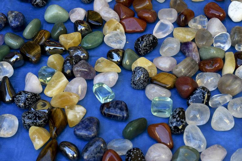 Full frame shot of blue and pebbles