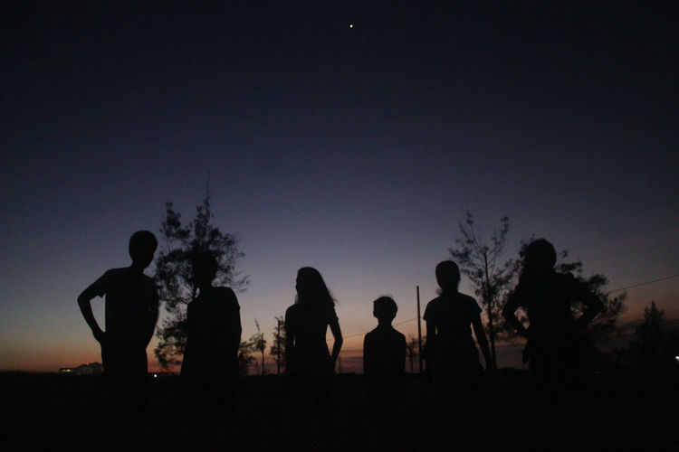 Blue Carefree Clear Sky Dark Group Of People Nature Outdoors Outline Person Scenics Silhouette Sky Solitude Standing Surface Level Tall Togetherness Tranquil Scene Tranquility