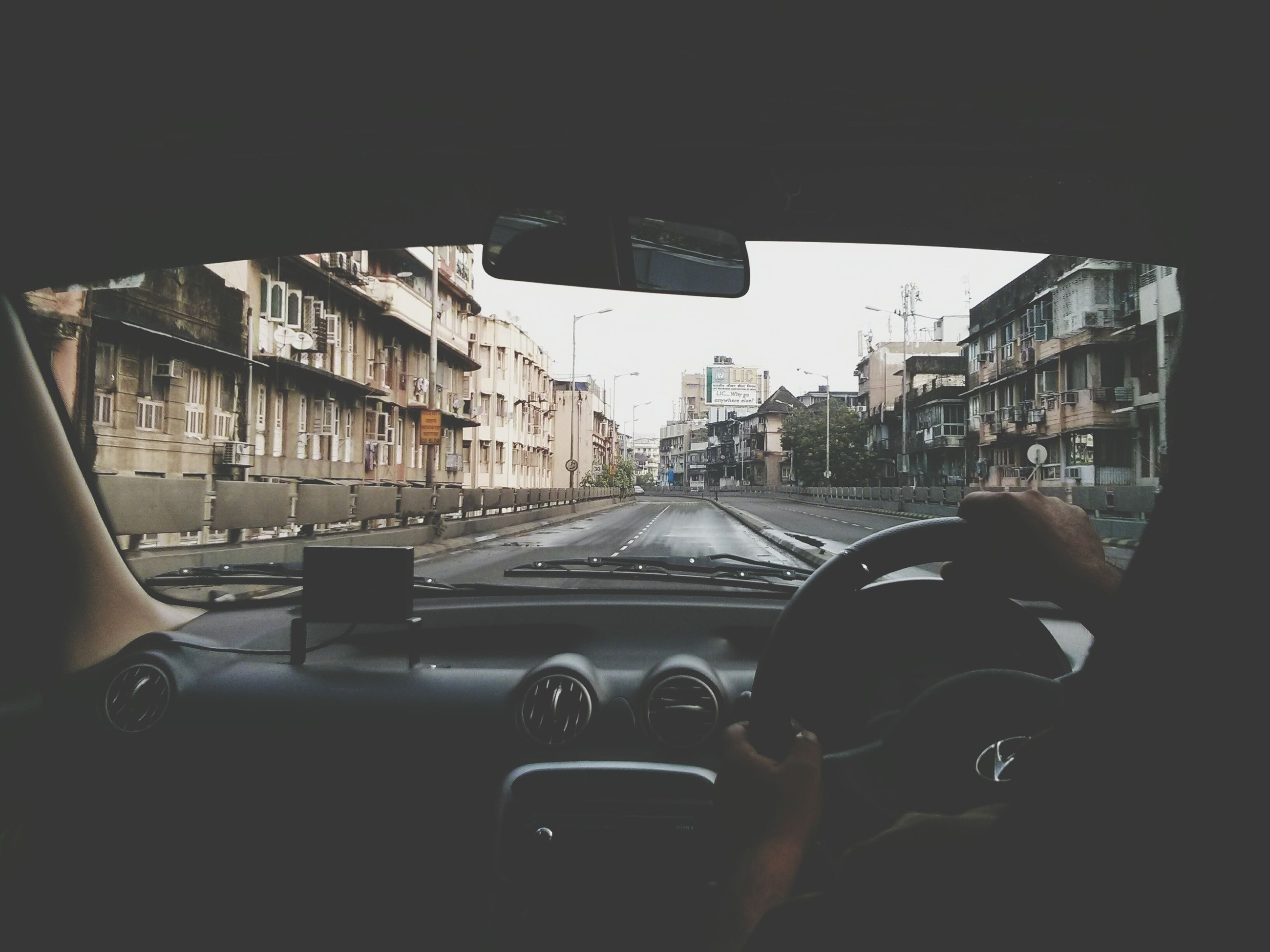transportation, mode of transport, land vehicle, car, vehicle interior, travel, men, public transportation, architecture, lifestyles, city, built structure, journey, on the move, glass - material, street, city life, window