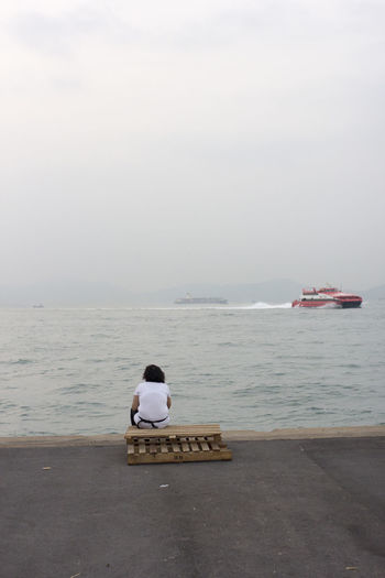 Admiring The View Asians Boat China Chinese Coastline Contemplating Harbour Hong Kong Hong Kong Harbour Instagram Pier Loneliness Lonely Ocean People Person Pier Sad Sea Street Photography The Street Photographer - 2016 EyeEm Awards