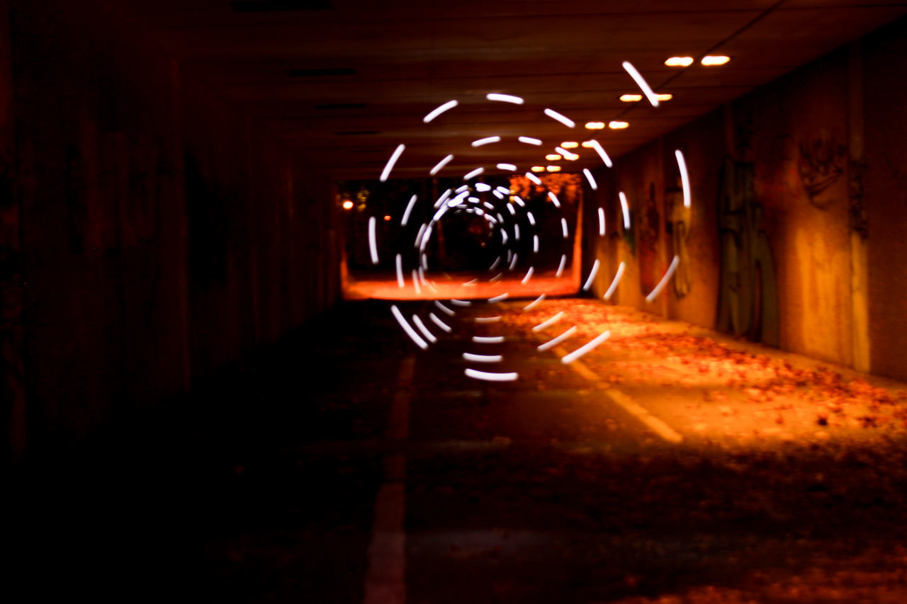 illuminated, in a row, the way forward, tunnel, indoors, night, architecture, full length, no people