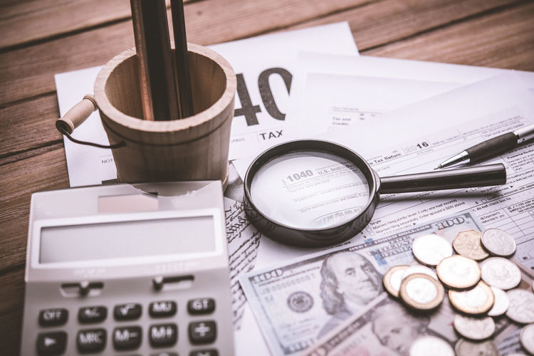 Still Life Finance Table Paper Indoors  No People High Angle View Text Currency Coin Close-up Communication Number Business Wealth Pen Western Script Calculator Document Selective Focus Economy