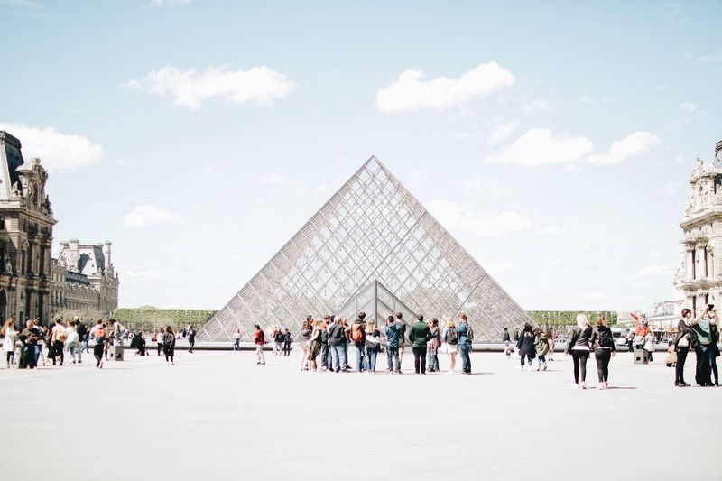 Paris EyeEm Selects Crowd Large Group Of People Group Of People Architecture Real People Sky Lifestyles Pyramid Building Exterior Tourist Nature Women Men Travel Destinations Tourism Travel Cloud - Sky Built Structure