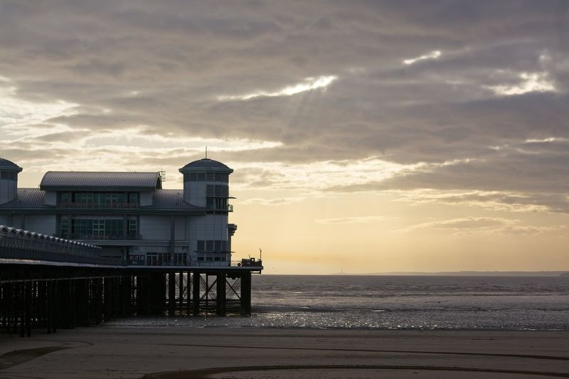 Early evening by the pier. Weston-super-mare Architecture Piier Sea Built Structure Horizon Over Water Architecture Water Sky Beach Cloud - Sky Sunset Scenics Building Exterior No People Outdoors