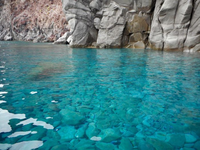 Water Beauty In Nature Blue Sea Rock Nature Waterfront Rock - Object Turquoise Colored Solid No People Scenics - Nature Tranquil Scene Non-urban Scene Swimming Pool Idyllic Land Outdoors Tranquility Day