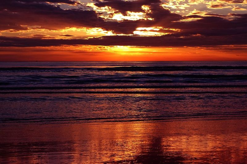 Sunrise Travel Travel Destinations Sunset Water Beauty In Nature Scenics - Nature Sky Orange Color Reflection Land Outdoors Non-urban Scene Sunlight Cloud - Sky Tranquil Scene Nature No People Sea Horizon Over Water Dramatic Sky Idyllic Tranquility