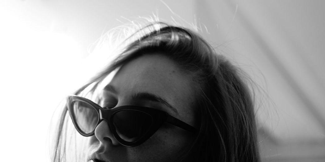 Close-up portrait of woman wearing sunglasses