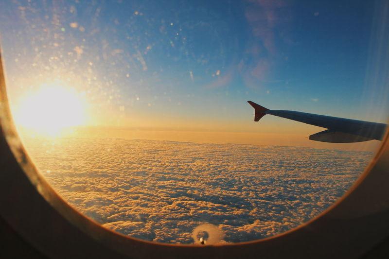 Airplane flying over landscape