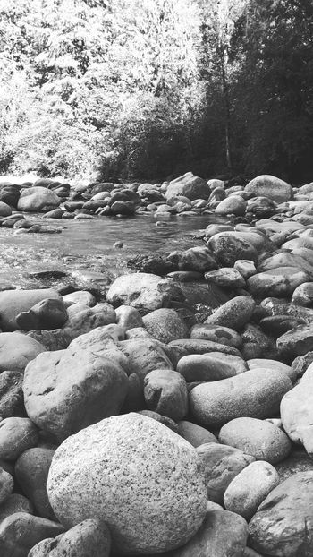 Rocks And Water Rocks Beauty In Nature Tranquility Flowing River Non-urban Scene Stone Outdoors Nature