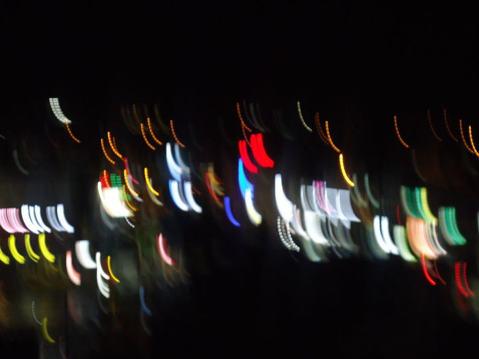 Black Background Close-up Glowing Hanging Illuminated Long Exposure Motion Multi Colored Night No People Outdoors Technology