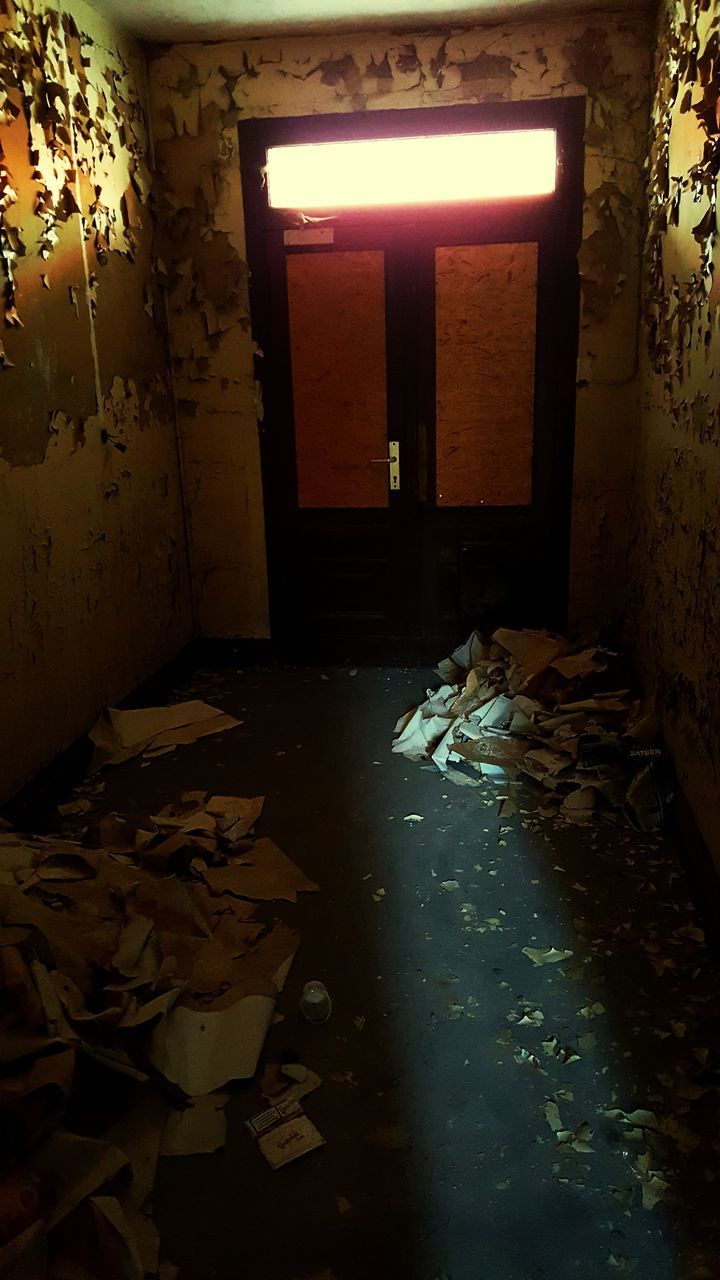 messy, indoors, abandoned, no people, domestic room, illuminated, lighting equipment, architecture, bed, damaged, home interior, flooring, furniture, bad condition, building, wall - building feature, bedroom, door, entrance, house, light, ruined, electric lamp, ceiling