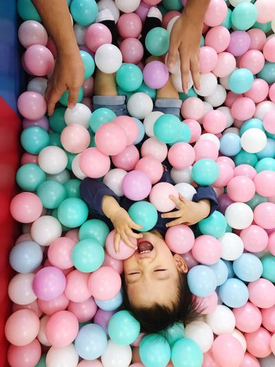 Playing in ball pool Happy Laughing Childhood colour of life Colors Parenthood Parent Hands High Angle View Balls Ball Pit Ball Pool EyeEm Selects Leisure Activity High Angle View Multi Colored Directly Above Relaxation Fun One Person Human Body Part Lying Down Lifestyles Body Part Real People Indoors  Enjoyment Front View
