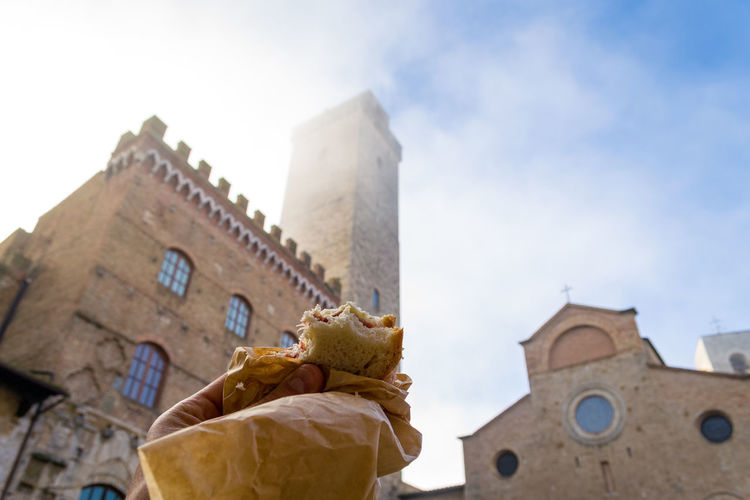 It was a very misty day and I was upset for it because i took a day off to visit this little medieval town in, after a little snack the sun showed up! EyeEmNewHere Hungry San Gimignano Sandwich Snack Architecture Bricks Building Exterior Day Food History Human Hand Italy Low Angle View Medieval Town Misty Morning Outdoors Prosciutto Crudo Real People Sky Tourism, Travel Destinations First Eyeem Photo