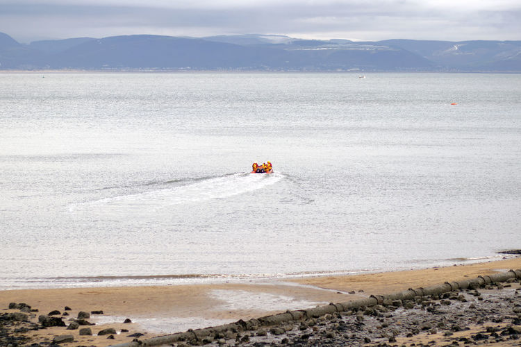 Water Scenics - Nature Beauty In Nature Mountain Sea Day Real People Beach Nature Sky One Person Cloud - Sky Land Tranquility Transportation Tranquil Scene Non-urban Scene Lifestyles Outdoors Inflatable  Mumbles Mumbles Rnli RNLI