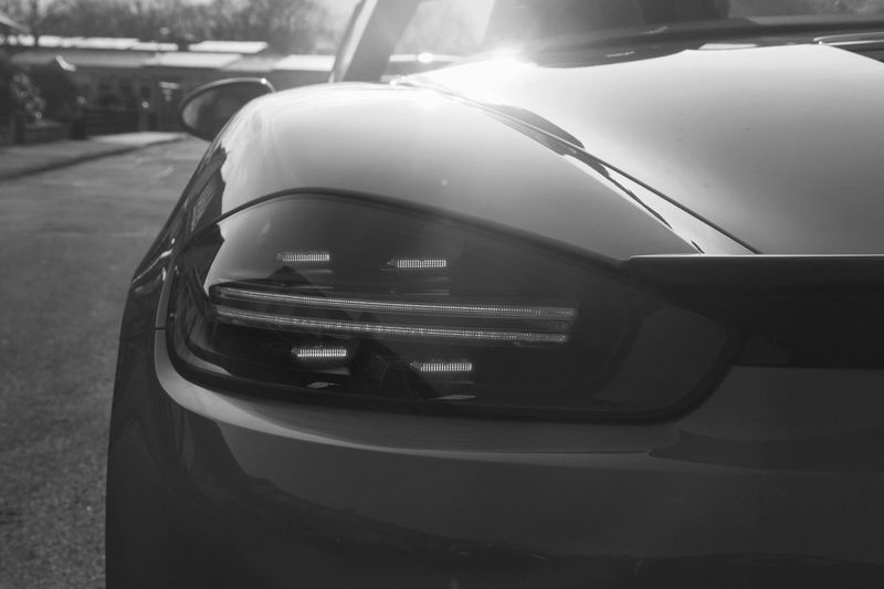 Porsche 718 Boxter Blackandwhite Carphotography Car Porsche Car Motor Vehicle Mode Of Transportation Transportation Land Vehicle No People Close-up Reflection Street Day Side-view Mirror Road City Stationary Focus On Foreground Sunlight High Angle View Glass - Material Nature Outdoors