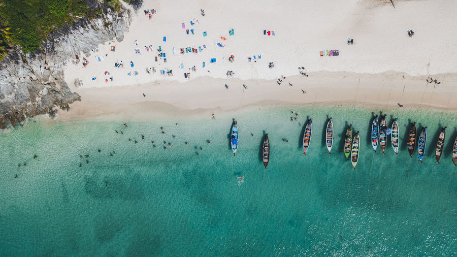 High angle view of people on sea shore