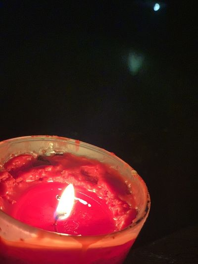 Close-up of lit tea light candle