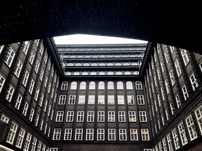 EyeEm Best Shots EyeEm Gallery Architectural Feature Architecture Building Built Structure Ceiling Chilehaus Hamburg City Day Design Eye4photography  Geometric Shape Glass - Material Indoors  Low Angle View No People Pattern Repetition Text Western Script Window EyeEmNewHere