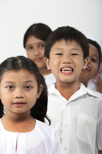 group of malaysia primary student with school uniform Happiness In A Row Indian Innocence Kids Patriotism Student Uniform Back To School Childhood Chinese Elementary Age Group Of People Harmony Malay Malaysia Mixed Race Multiracial  Portrait Primary Students School Uniform Smiling Studio Shot United White Background