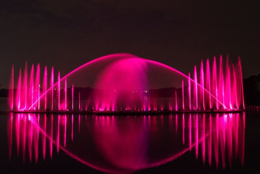 Water Dance Illuminated Water Arts Culture And Entertainment City Reflection Pink Color Sky Architecture
