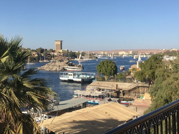 Aswan Egypt Aswan ♥♥ Aswan, Egypt Boats⛵️ Nature Nile River Aswan Boat Cityscape Clear Sky High Angle View Nature Nile No People Outdoors Rocks Sky Sunlight Sunset Tree Water النيل مصر First Eyeem Photo