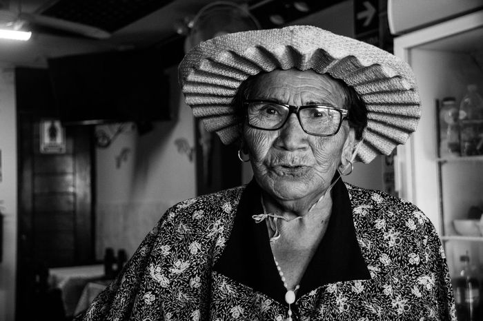 The jungle woman EyeEmNewHere Blackandwhite Photography Black And White Experienced Peru Iima Life Stories Strength Indigenous  Woman Female Strength Jungle Woman Jungle Experience Portrait Glasses Front View Eyeglasses  Real People Looking At Camera One Person Mature Adult Lifestyles
