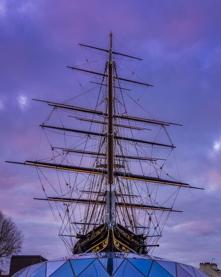Low angle view of sailboat against sky at dusk