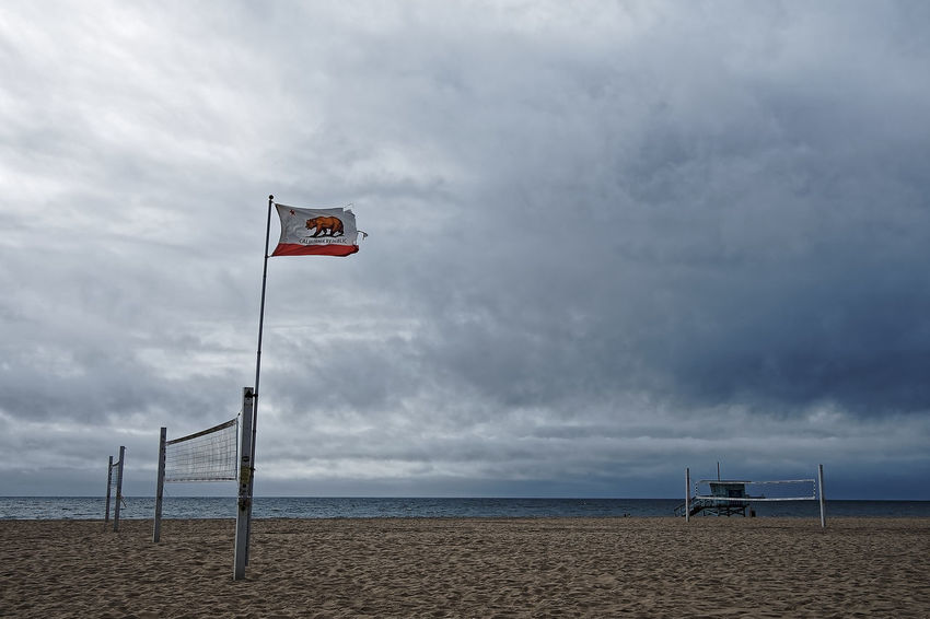 Winter Beach Beauty In Nature Cloud - Sky Day Flag Hermosa Horizon Over Water Nature No People Ocean Outdoors Pacific Ocean Patriotism Sand Scenics Sea Sky Water