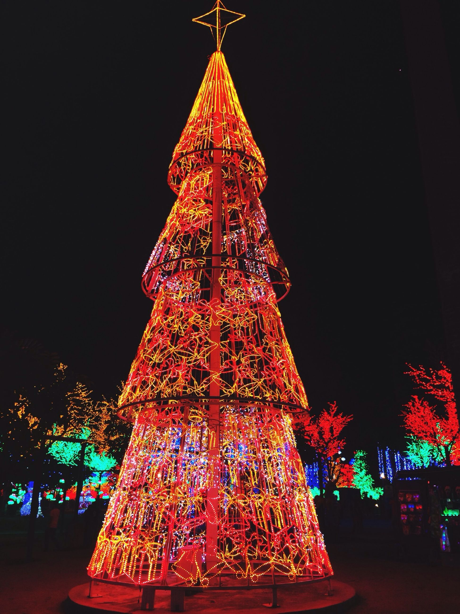 illuminated, night, christmas, celebration, decoration, low angle view, built structure, tradition, architecture, christmas decoration, christmas tree, christmas lights, building exterior, cultures, lighting equipment, religion, famous place, travel destinations, art and craft, art