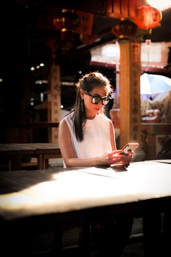 Young woman looking at phone