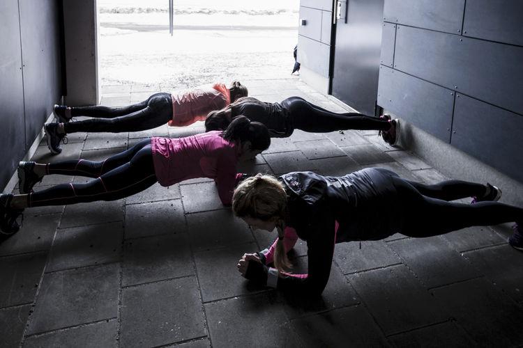 Rear view of women lying on floor