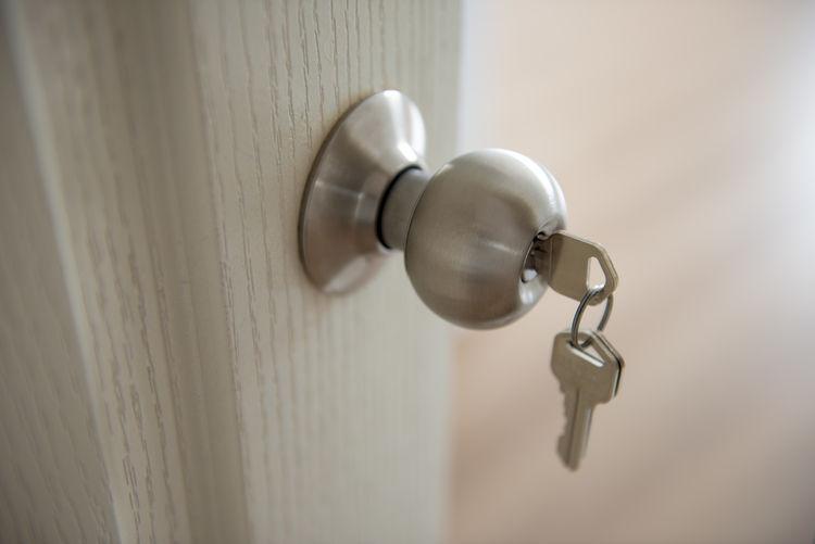 Close-Up Of Keys On Doorknob