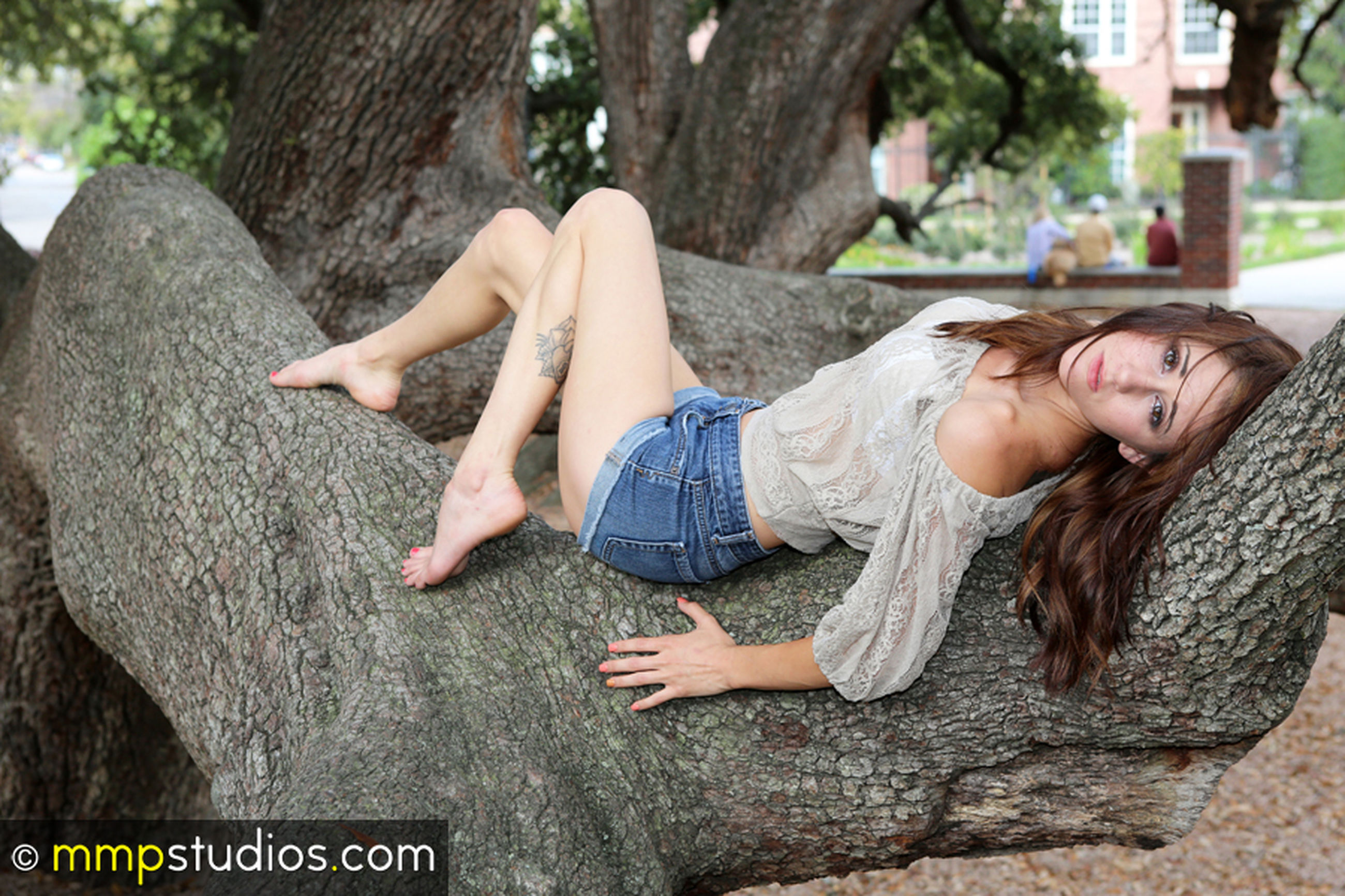 full length, casual clothing, one person, leisure activity, young women, young adult, hair, real people, lifestyles, tree trunk, nature, long hair, trunk, women, day, lying down, hairstyle, tree, outdoors, beautiful woman