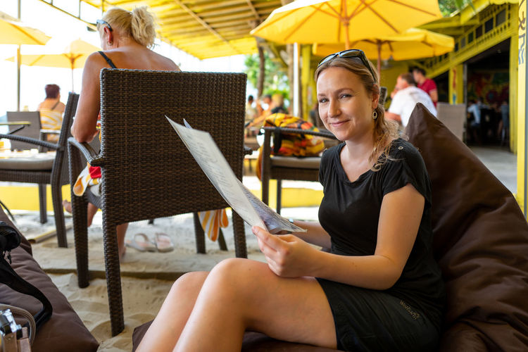 Langkawi Sitting Women Young Adult Adult Young Women Leisure Activity Three Quarter Length Real People Holding Chair People Incidental People Seat Smiling Business Blond Hair Indoors  Two People Focus On Foreground Hairstyle