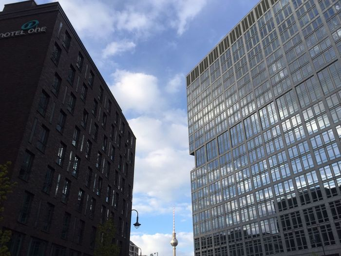 Architecture Building Building Exterior Built Structure City City Life Cloud Cloud - Sky Cloudy Day Development Low Angle View Modern No People Office Building Outdoors Sky Skyscraper Tall Tall - High Tower Weather