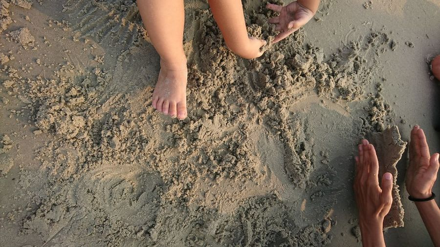 Low section of girl on sand