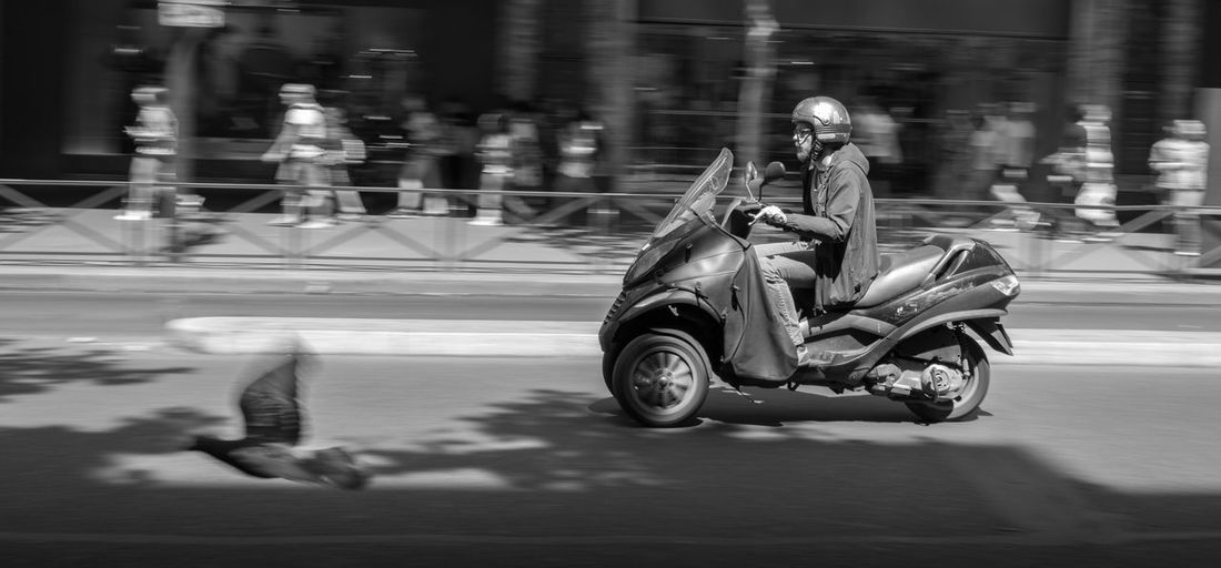 Streetphotography Blackandwhite City Life Real People Cityscapes Leisure Activity Transportation The Way Forward Perspective Focus On Foreground Cityscape Motorcycles Paris