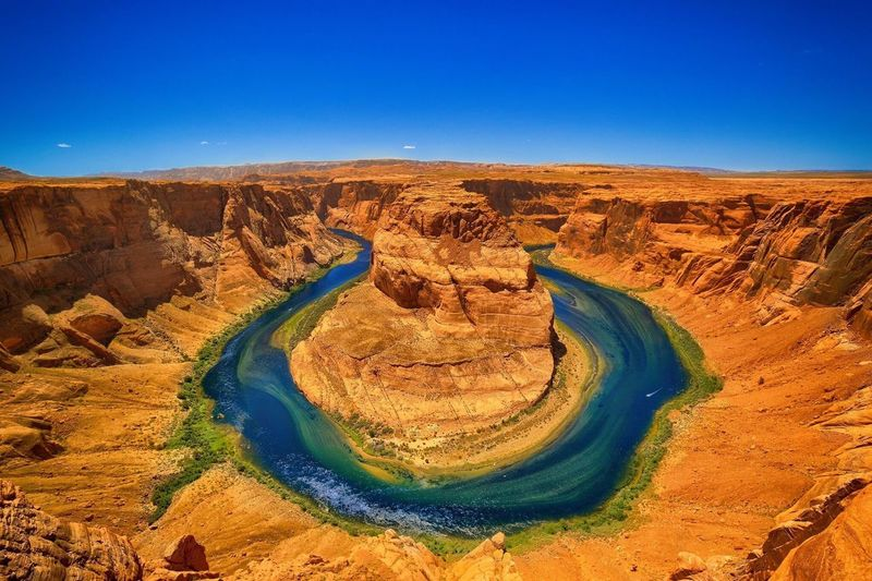 Scenic View Of Horseshoe Bend Against Clear Blue Sky